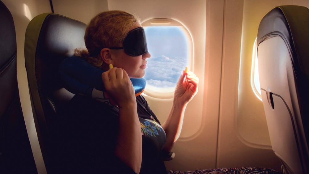 5 Tips om beter te slapen in het vliegtuig